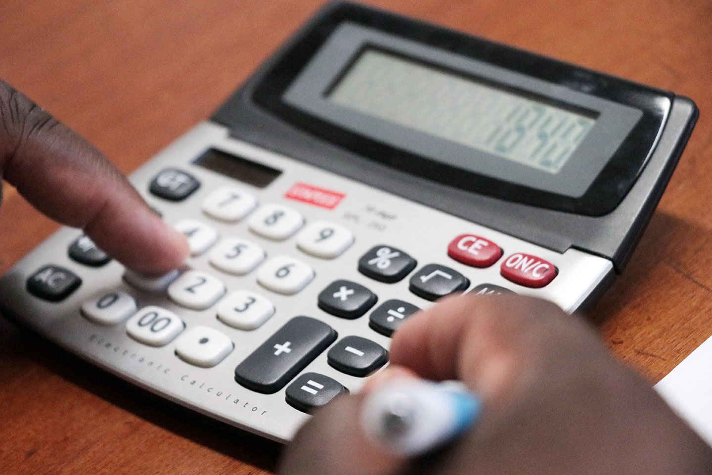 Closeup of person using calculator
