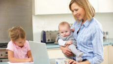 Mom with kids using computer