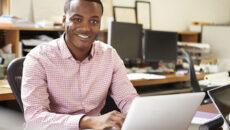 Guy on laptop in office