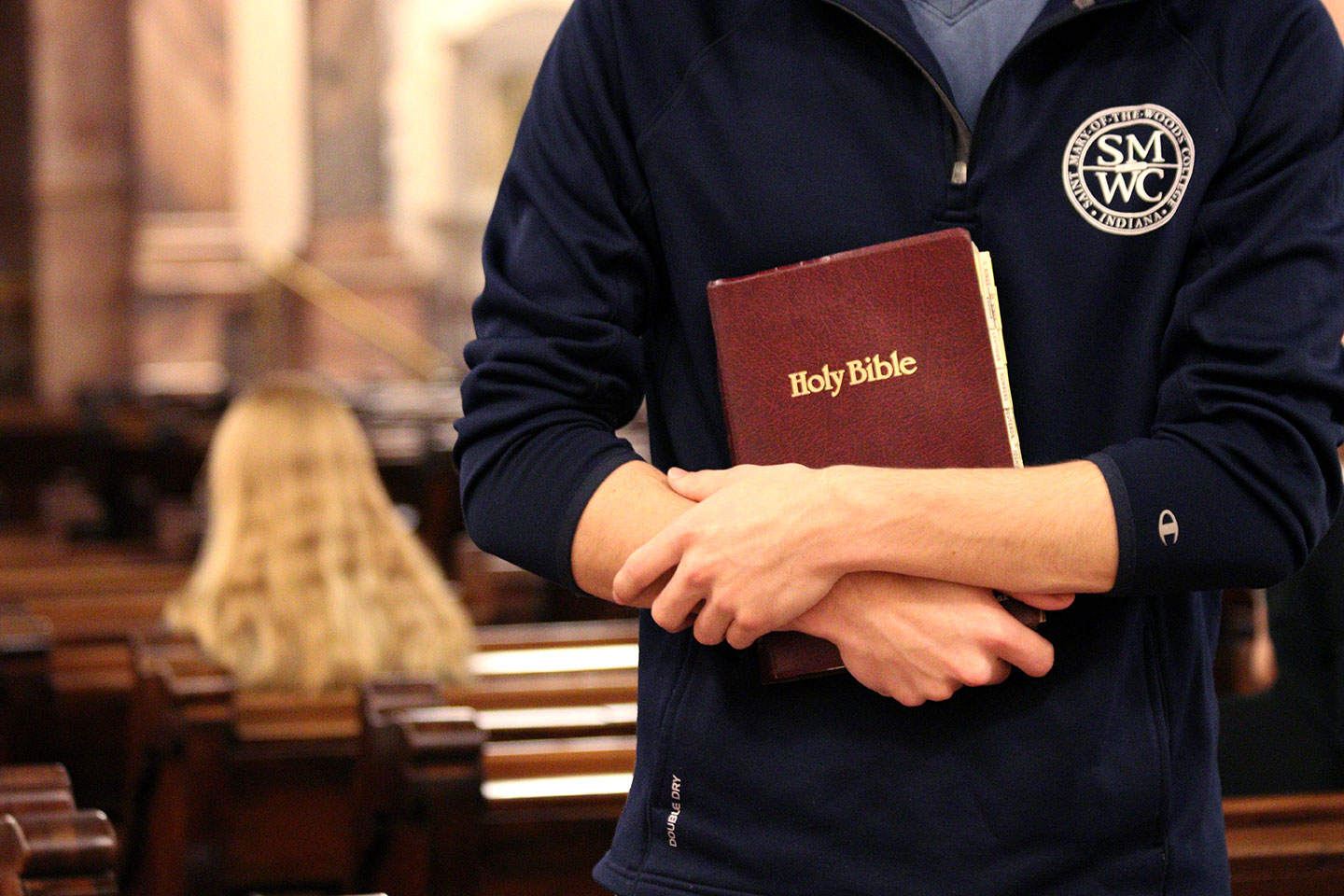 student holding bible