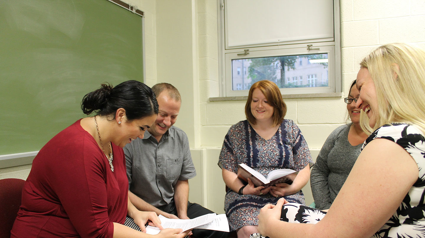 graduate students talking and reading
