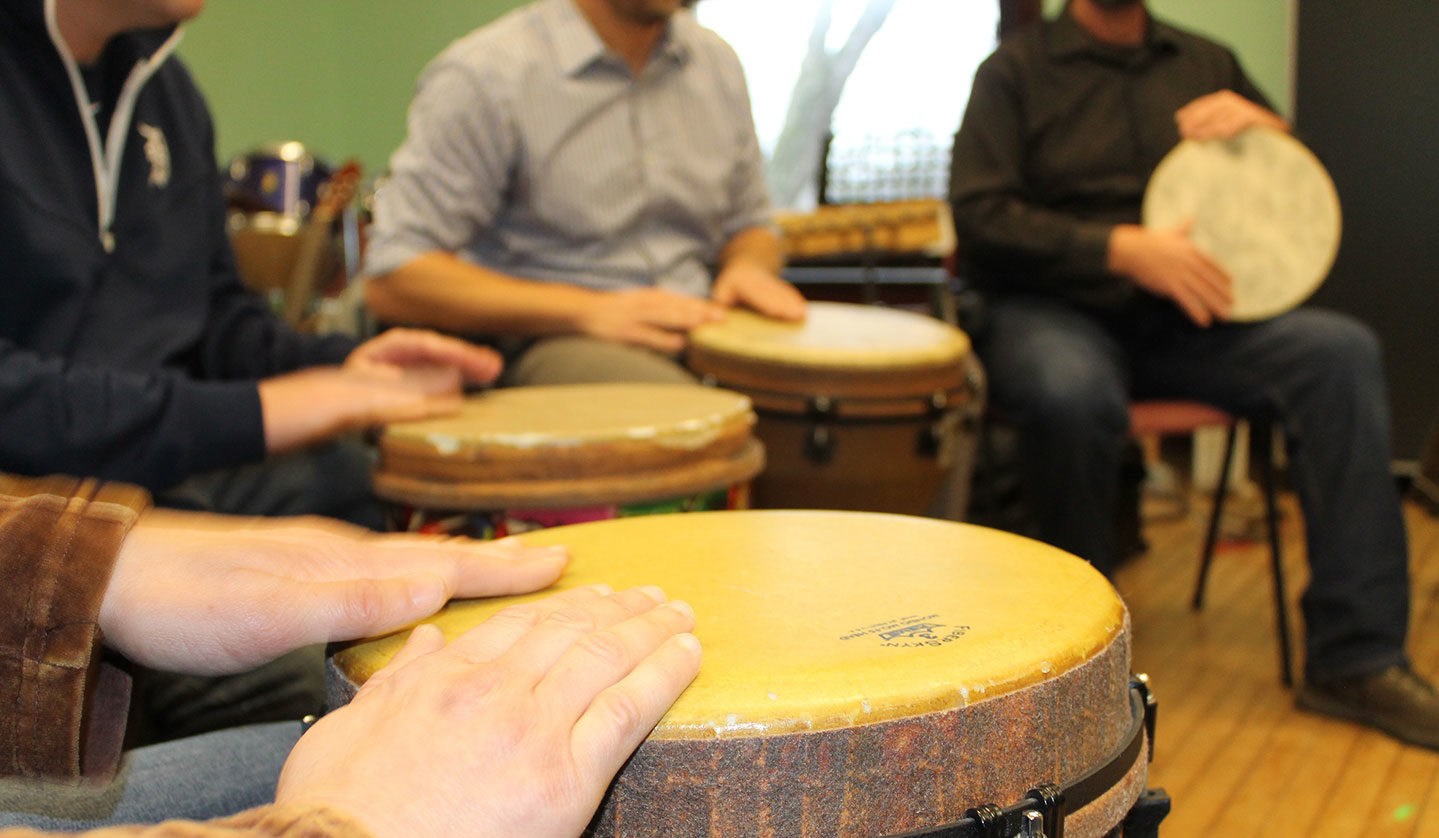 closeup of students playing drums