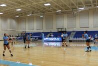 Volleyball players on the floor of Hamilton Arena
