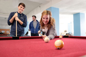 Students playing a game of pool