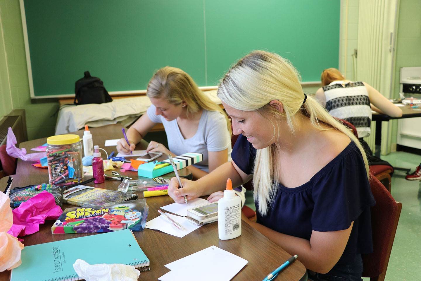 Graduate students working on an art project