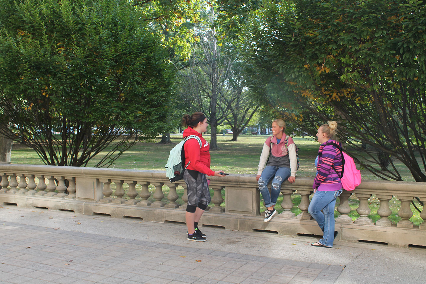 Students talking on the porch of Guerin Hall