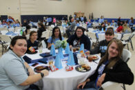 Students eating in the auxiliary gym