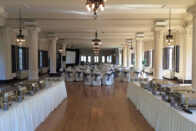 The ballroom set up for an event with buffet tables