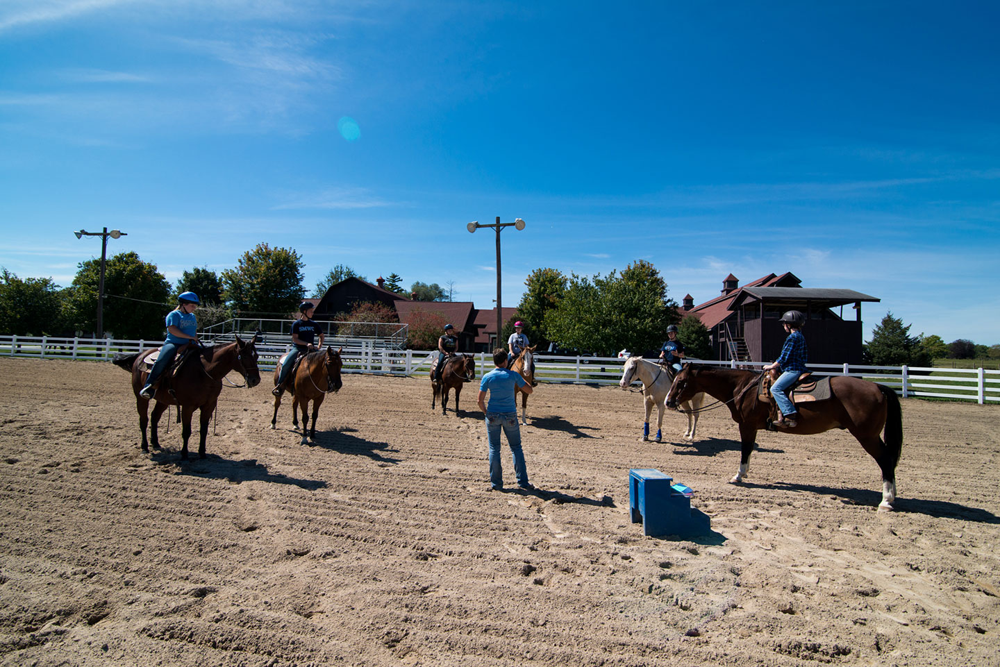 Students on horses with equine professor