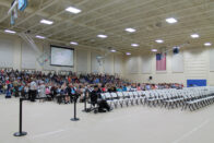 The gym filled with people for commencement