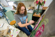 Student painting flowers