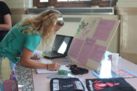 Student at the peace and justice club table