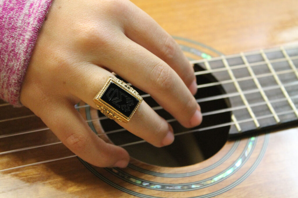 Woods ring and a guitar