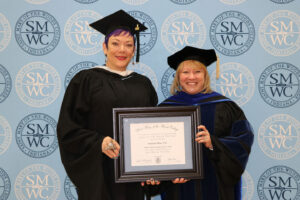 Stephanie Wray standing with President King holding award