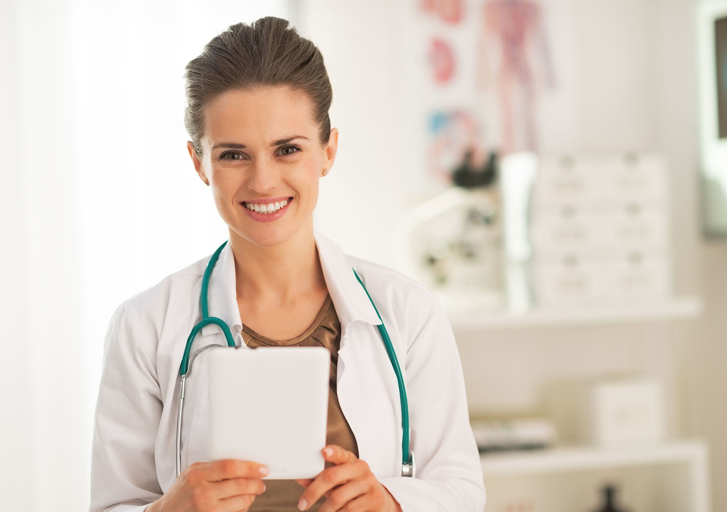 Young nurse standing smiling in clinic
