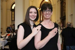 Madeline and Valerie Grumieaux posing with Woods Rings at the reception