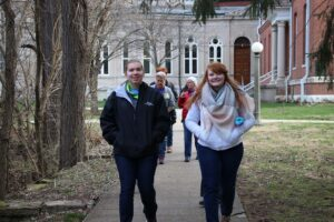 Students walking between stations on the walk