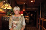 Diane Richards standing in Stables Steakhouse