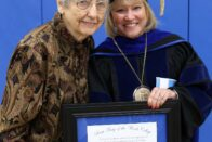 Dorthy Weinz Jerse stands with President King holding award