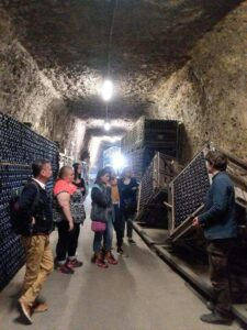 Participants of the faculty-led tour to France visit a wine cellar in the town of Amboise.