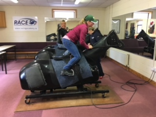 Student Adrienne Vanmatre testing her skills on the mechanical race horse at the Racing Academy and Centre of Education (RACE).