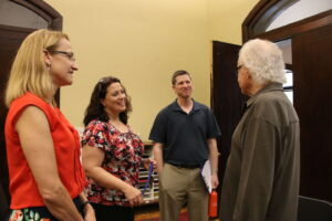 Music faculty talking with Ron Oates at the Conservatory of Music at SMWC