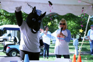 Onyx the horse gives a thumbs up as President King introduces her as the new mascot.