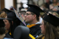 Student looks intently forward during the Spring 2018 commencement ceremony.