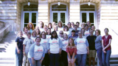 Group of legacy students and their family pose for a group photo on the steps of the conservatory of music.