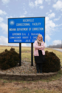 Henson standing in front of Rockville Correctional Facility sign