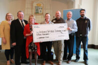 Representatives from SMWC, Duke Energy, and the Indiana Wildlife Federation hold a large check for $15,000 at the ceremony