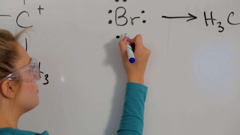 Student drawing chemistry formulas