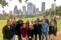 Group photo in front of the Houston skyline