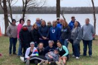 Group of students and family at the lake