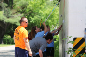 SMWC staff painting the viaduct