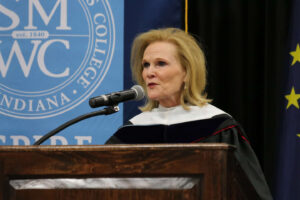 Lubbers speaking at the commencement podium