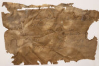 A faded brown paper with the builder's note