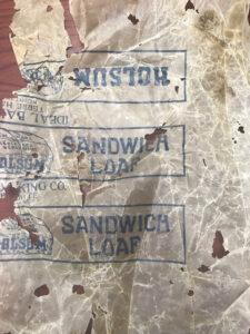 A torn piece of wax sandwich paper