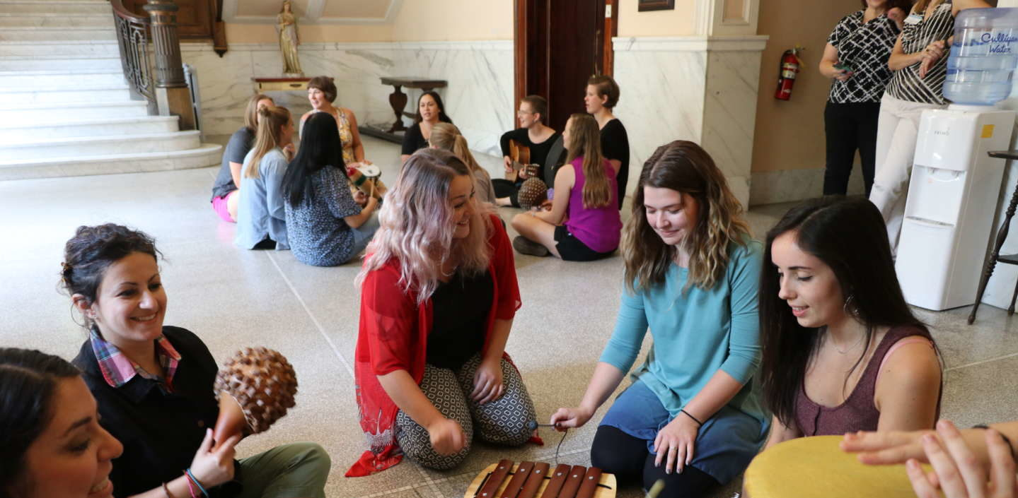 MAMT students playing instruments in the conservatory of music