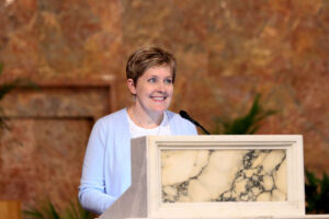 Clark at the podium of the church