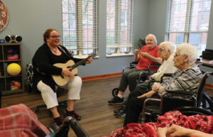 Natalie Coffin playing music for patients in Providence Health Care