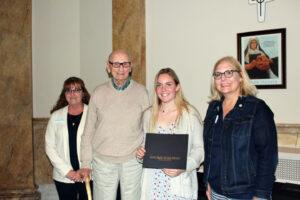 Sophia Ricard accepting her scholarship certificate
