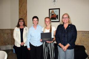 Kaileigh Pruitt accepting her scholarship certificate