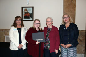 Sara Langenberger accepting her scholarship certificate