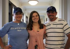 Student with her parents during move-in 2019