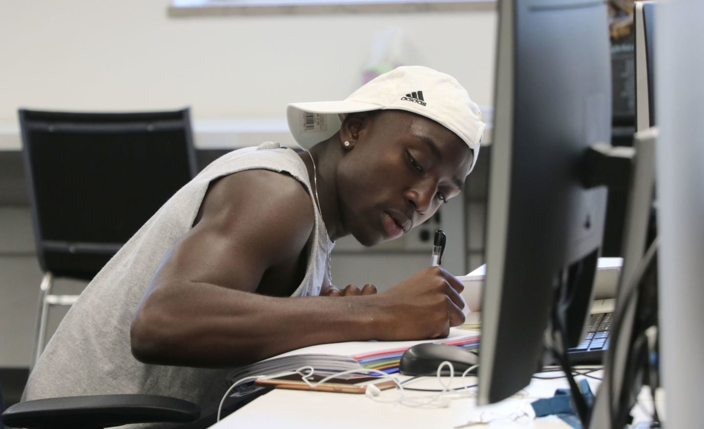 Student writing at LRC desk