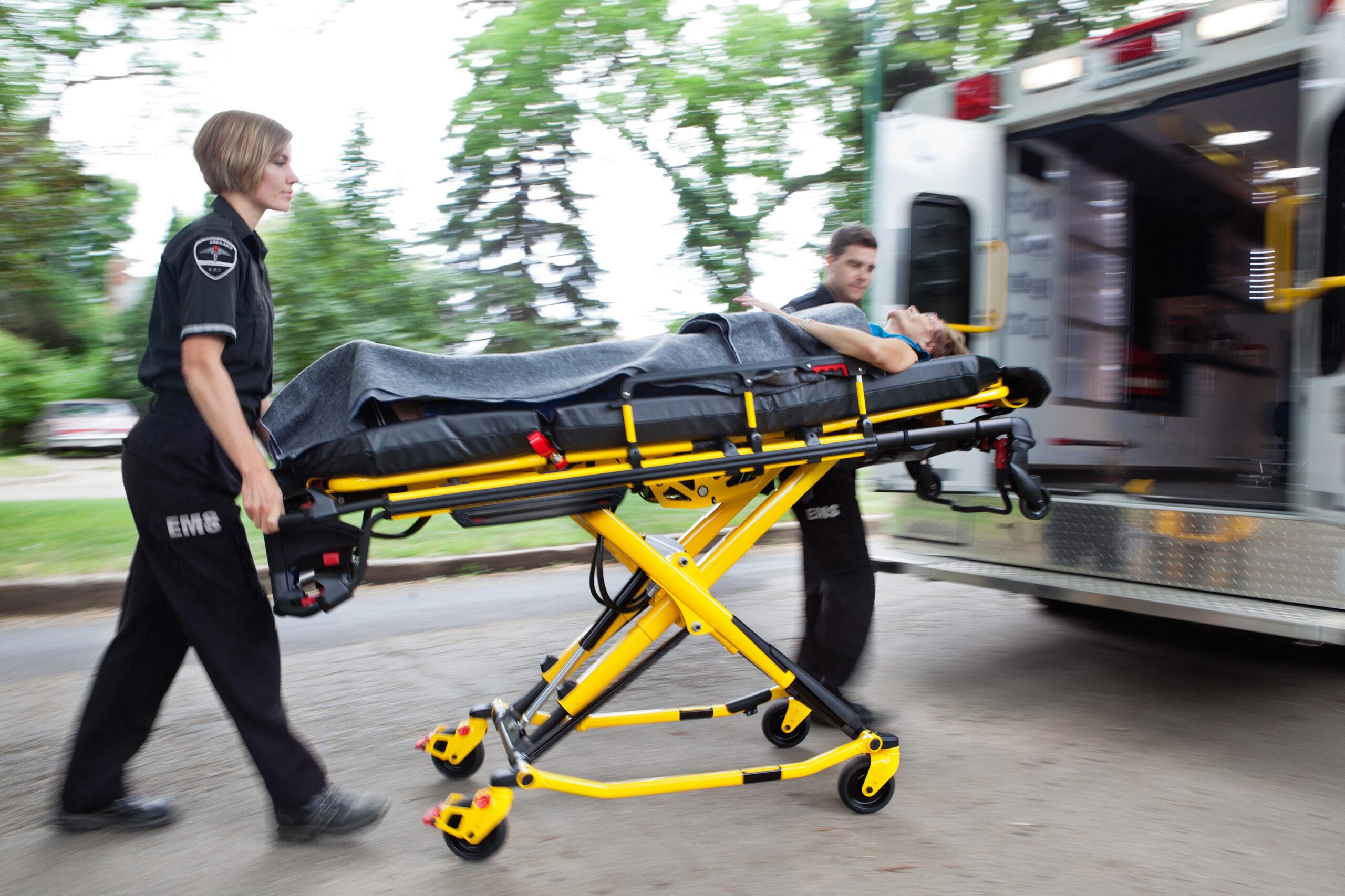 Paramedics taking a patient to an ambulance