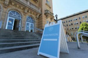 Registration day sign in front of Le Fer Hall