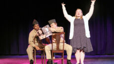 Student belting a music number during the fall play