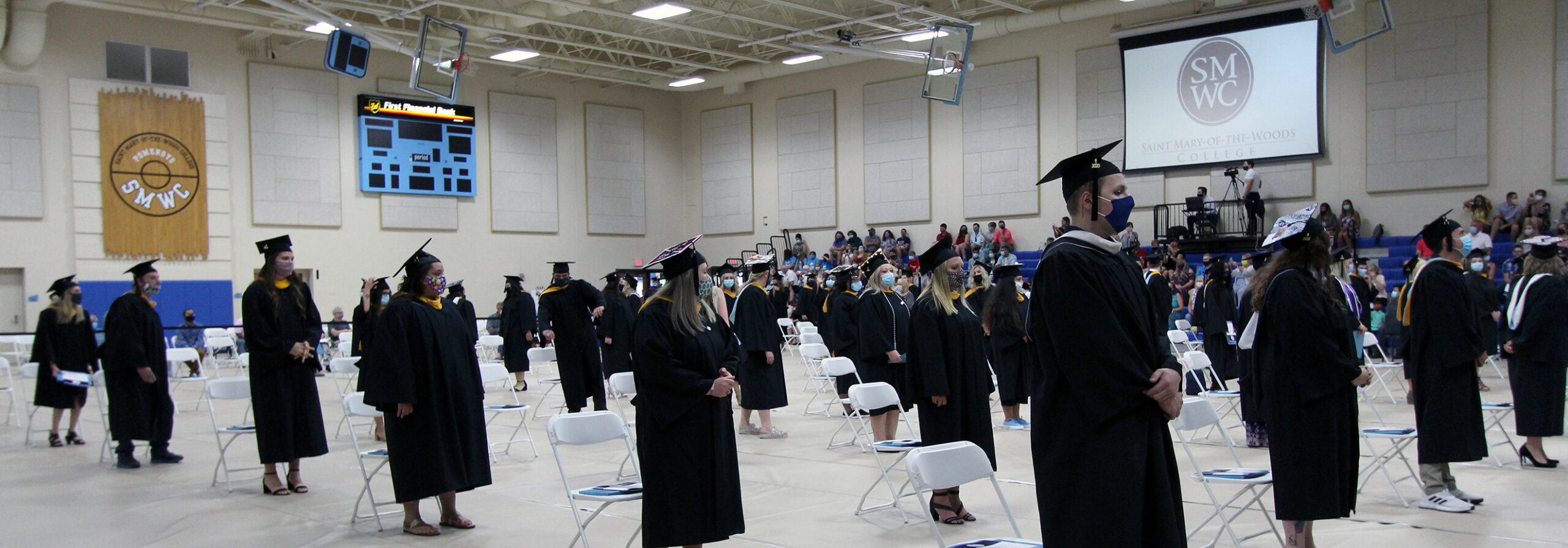 Graduates standing at commencement